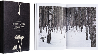 A cover and a spread of the book Perintö - Legacy.